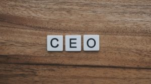 tiles that spell CEO on a table